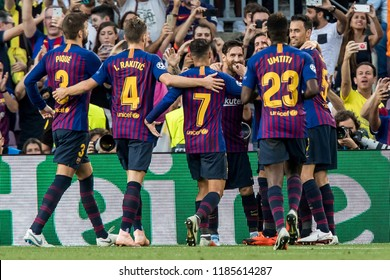 SPAIN, BARCELONA - September 18 2018: Lionel Messi scores and celebrate with Sergi Roberto (r) and Samuel Umtiti (l) During the FC Barcelona - PSV Champions League Match.