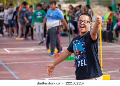 "Spain, Benidorm, 10/26/2018: Children with Down Syndrome participate in sports activities on the ""Day of Supporting Leukemia Patients"". Down syndrome. Disabled children. Charity."