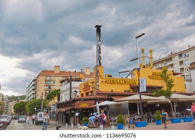 SPAIN, Calella - SEPTEMBER 15, 2016: Restaurant with yellow signboard in Calella, Spain.