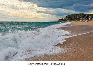 SPAIN, Calella - SEPTEMBER 15, 2016: Seascape in cloudy weather in the evening in Calella, Spain.