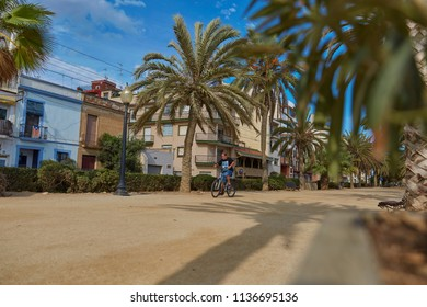 SPAIN, Calella - SEPTEMBER 15, 2016: Palm Alley near houses against the blue cloudless sky in the afternoon in Calella, Spain.