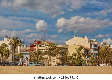 SPAIN, Calella - SEPTEMBER 15, 2016: Cloudy sky over houses on the beach in Calella, Spain.