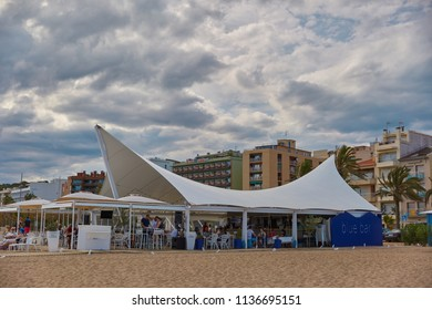 SPAIN, Calella - SEPTEMBER 15, 2016: Open cafe under the awning on the beach in Calella, Spain.