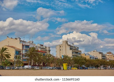 SPAIN, Calella - SEPTEMBER 15, 2016: Residential houses under a cloudy sky on the beach in Calella, Spain.