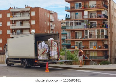 SPAIN, Calella - SEPTEMBER 15, 2016: The truck stopped on the roadside to unload the cargo in Calella, Spain.
