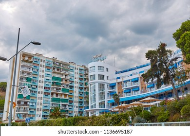 SPAIN, Calella - SEPTEMBER 15, 2016:  A bright multi-apartment residential complex near greenery in Calella, Spain.