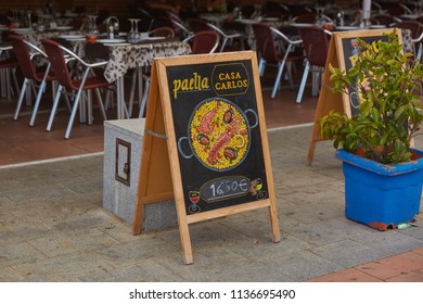 SPAIN, Calella - SEPTEMBER 15, 2016: Chalkboard on a wooden stand near the cafe in Calella, Spain.