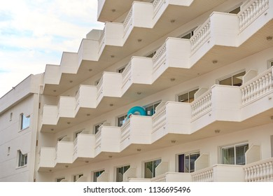 SPAIN, Calella - SEPTEMBER 15, 2016:  A multi-storey residential building with balconies in beige color in Calella, Spain.