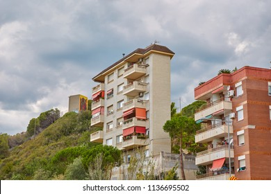 SPAIN, Calella - SEPTEMBER 15, 2016: Multi-storey houses with balconies in the afternoon in Calella, Spain.