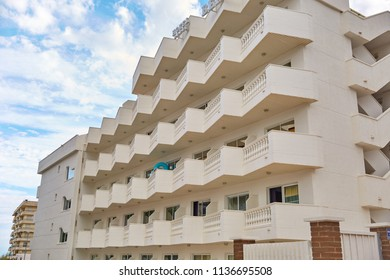 SPAIN, Calella - SEPTEMBER 15, 2016: Multi-storey residential building with balconies of beige against the sky in Calella, Spain.