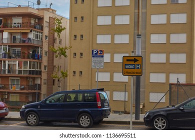 SPAIN, Calella - SEPTEMBER 15, 2016: The dark blue car parked in a parking  near a multi-storey residential building in Calella, Spain.