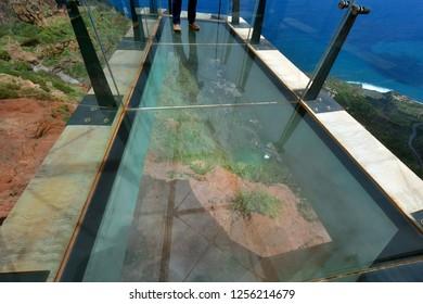 Spain, Canary Islands, La Gomera, Skywalk with view through glass floor down to Agulo village and Atlantic ocean , mirador de Abrante,