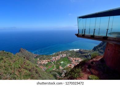 Spain, Canary Islands, La Gomera, glass skywalk Mirador de Abrante with view to village Agulo, Atlantic ocean and peak of Teide Mountain in Tenerife