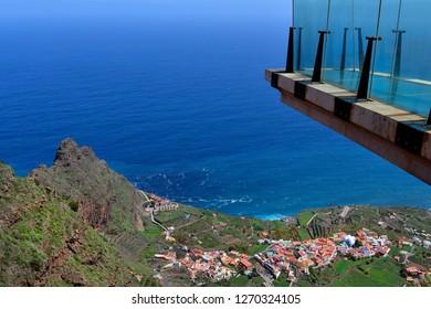 Spain, Canary Islands, La Gomera, glass sky-walk Mirador de Abrante with view to village Agulo on Atlantic ocean