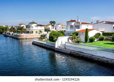 Spain, Catalonia, Costa Brava, Empuriabrava: Skyline panorama view with yachts, boats, waterways, blue sky. The Spanish tourist destination has the largest residential marina in Europe. June 29, 2018
