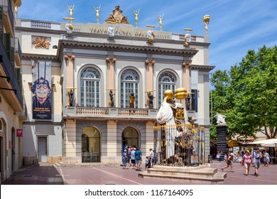 Spain, Catalonia, Figueres: Front facade with sculptures and main entrance of the Dali Theatre and Museum in the city center of the Catalan hometown of the world famous Spanish artist. June 27, 2018
