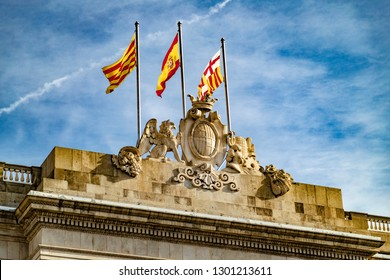 spain and catalunya flags and amblem and lions sculpture in barcelona