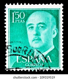 """SPAIN - CIRCA 1955: A stamp printed in Spain shows a portrait of General Francisco Franco (1892-1975) without inscription, with imprint: �F.N.M.T.�, from the series """"Francisco Franco"""", circa 1955."""