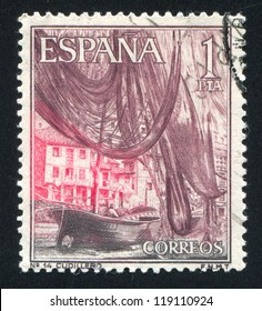 SPAIN - CIRCA 1964: stamp printed by Spain, shows Boat and nets in Cudillero Harbour, circa 1964