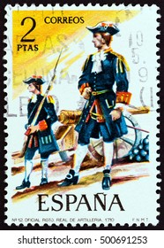 "SPAIN - CIRCA 1974: A stamp printed in Spain from the ""Military Uniforms"" issue shows Officer, Royal Regiment of Artillery, 1710, circa 1974."