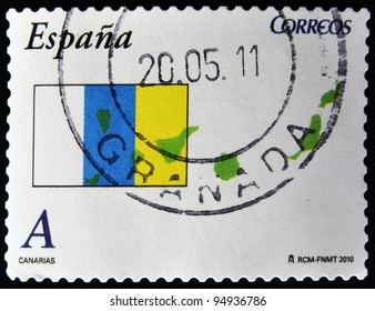 SPAIN - CIRCA 2010: A stamp printed in spain shows flag and map of the autonomous community of canary islands, circa 2010