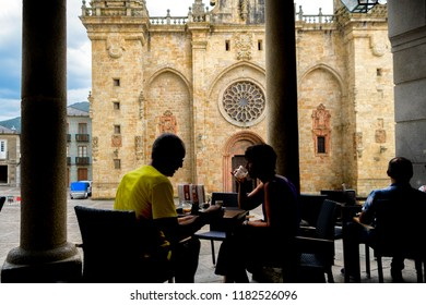 Mondoñedo, Spain. Circa August 2018. Unidentified tourists have a drink in downtown Mondoñedo, Galicia, Spain, next to historic cathedral.