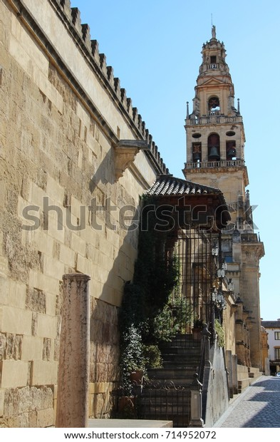 SPAIN, CORDOBA, CALLE CARDENAL HERRERO, AUGUST 05, 2017: Belltower of the Mezquita in the andalusian Cordoba