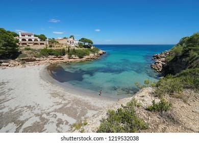 Spain Costa Dorada peaceful cove with sandy beach and coastal houses, Mediterranean sea, Cala Estany Tort, Catalonia, L'Ametlla de Mar, Tarragona