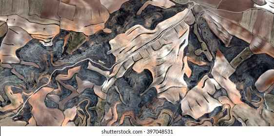 Spain is diferent, abstract photography of the Spain fields from the air, bird's eye view, tribute to Pollock, artistic representation of human labor camps, abstract expressionism, contemporary art,
