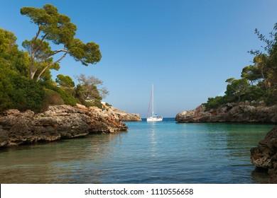 Spain, Europe, May 7, 2018. People enjoying a boat ride at Cala Egos, Cala D'or, Mallorca