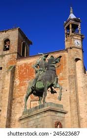 "Spain, Extremadura, Caceres, The historical town of Trujillo. Plaza Mayor, Saint Martin's church and statue of Fransisco Pizarro - ""The Conqueror of Peru"", born in Trujillo."