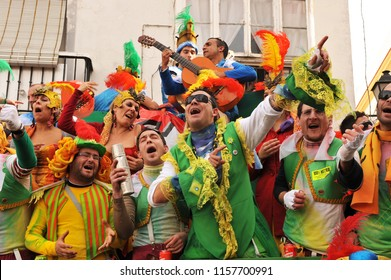 Cádiz, Spain - Feb 20, 2010: A typical carnival chorus (chirigota) sings in the streets during the famous Carnaval of Cadiz, Andalusia, Spain