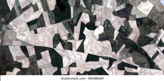 Spain fields from the air, artistic representation of human labor camps bird's eye view, abstract photograph of the Spain fields from the air, which mimic an abstract painting  labor camps