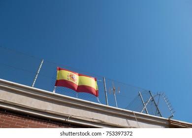 Spain flag with sunny blue sky