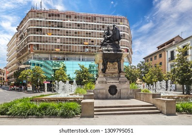 Spain, Granada - June 25, 2018: Fountain in Piazza Isabella la Cattolica in Granada in Andalusia, a homage to Queen Isabella and to Columbus