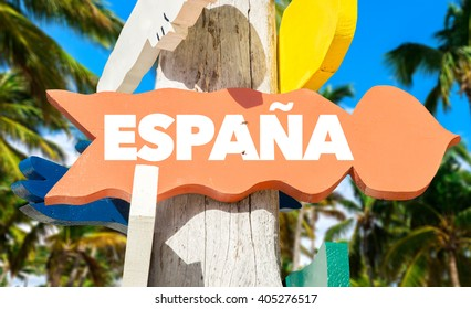 Spain (in Spanish) signpost with palm trees