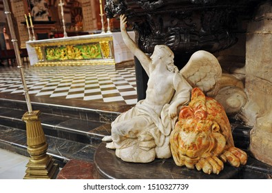Córdoba, Spain - July 12, 2012: Angel and Lion symbols of the Evangelists Mattew and Mark. High Altar of the Cathedral - Mosque of Cordoba, Andalusia, Spain