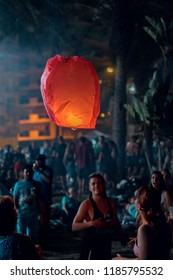 MÁLAGA, SPAIN - JUNE 23, 2018 - Pictures of Saint John night celebrations on the Malagueta beach in Málaga. Sky is full of lanterns and at the midnight are people swimming at the sea.