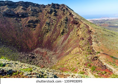 Spain, Lanzarote, Red volcanic soil of giant volcanic crater of volcano corona from crater rim
