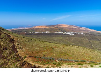 Spain, Lanzarote, View north over the island and town ye from crater rim of volcano monte corona