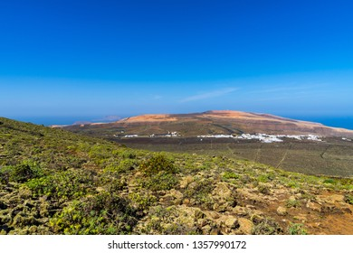 Spain, Lanzarote, Wide view over winegrowing countryside of ye from volcano la corona