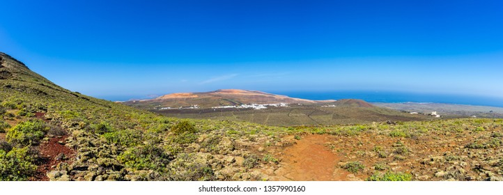 Spain, Lanzarote, XXL panorama of winegrowing and cactus countryside of town ye from volcano monte corona