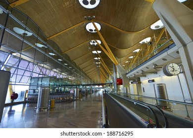 SPAIN, MADRID - APRIL 7, 2014: Madrid Barajas Airport, Terminal 4 departures. Designed by Antonio Lamela and Richard Rogers, built by Ferrovial it was inaugurated on 5 February 2006