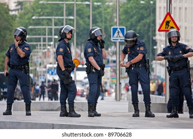 Spain, Madrid - May 26: Spanish Police by closing the street to the Congress building during the Protests in Spain against the spanish economic crisis and political system in Madrid on May 26, 2011.