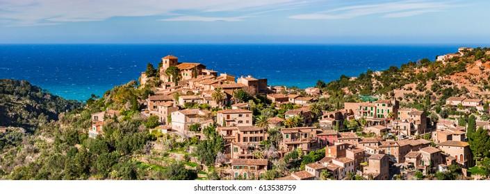 Spain Majorca island, panorama of the old mediterranean mountain village Deia, beautiful landscape scene Balearic Islands.