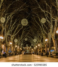 Spain Majorca Palma old town center, view to the alley passeig de born, lighted at Christmas season.