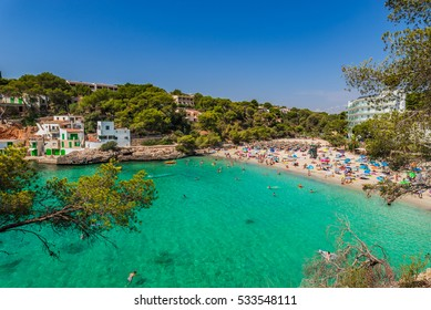 Spain Majorca summer holiday beach of Cala Santanyi, Mediterranean Sea, Balearic Islands.