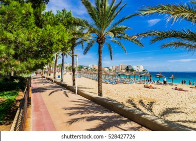 Spain Majorca, view to the coastline and promenade alley of Magaluf sand beach, mediterranean sea coast.