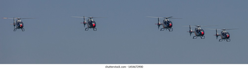 """Spain, Malaga on July 14, 2019, aerial display of the helicopter patrol """"ASPA"""""""
