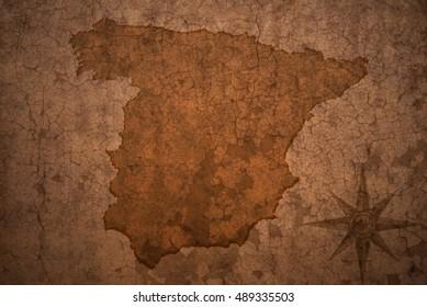 spain map on a old vintage crack paper background